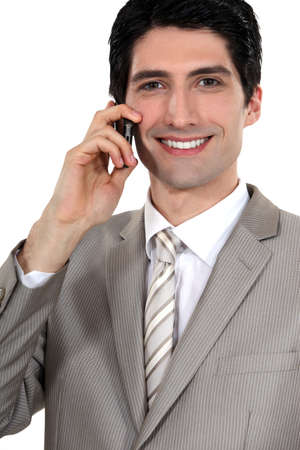 Happy businessman with mobile telephone photo