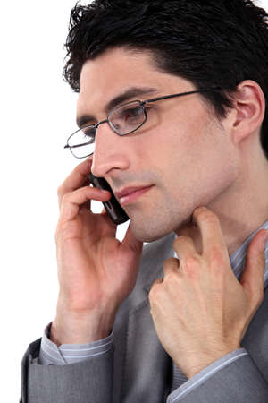 guileless: Closeup of a bespectacled businessman on the phone Stock Photo