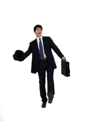 apparently: Man in a suit with briefcase and hat Stock Photo