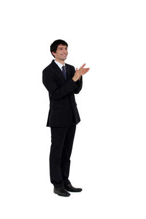 acclamation: Businesses man applauding Stock Photo