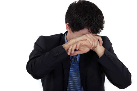 humiliation: Man hiding his face in shame