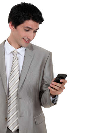 Businessman excited by text message in mobile photo