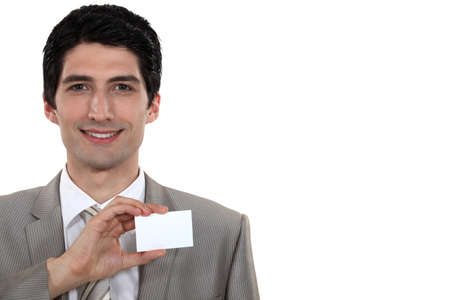 individualized: Businessman holding up his business card