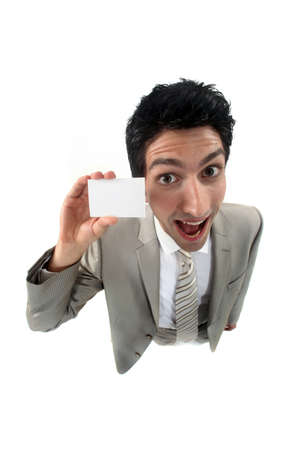 sense of space: young businessman holding business card playing the fool