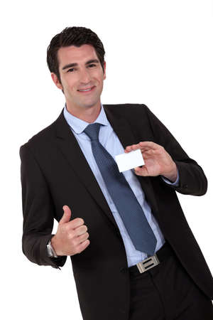 businessman showing card photo