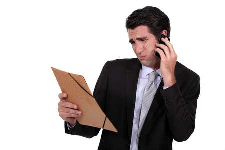 dubious: A dubious businessman over the phone.