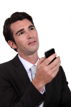 replying: Man thinking before replying to text message