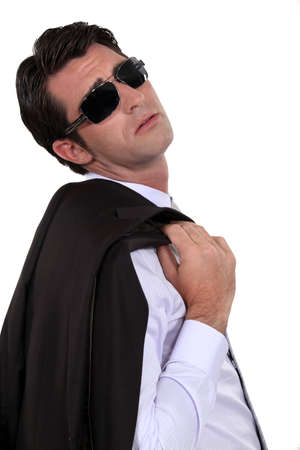 indifferent: Businessman wearing sunglasses