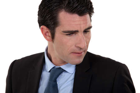 consternation: A frowning businessman