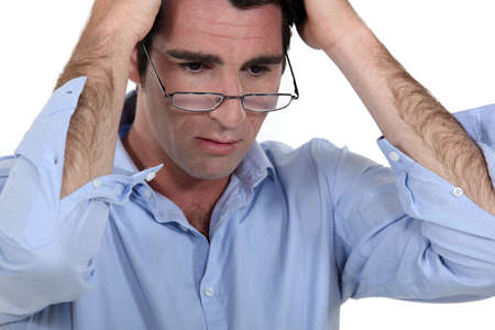 realize: Stressed man wearing glasses Stock Photo