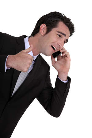 Businessman receiving good news photo