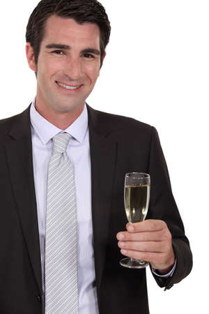 Confident businessman holding glass of champagne photo