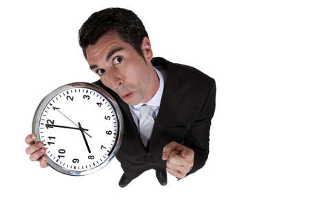 High-angle shot of a businessman holding a clock Stock Photo