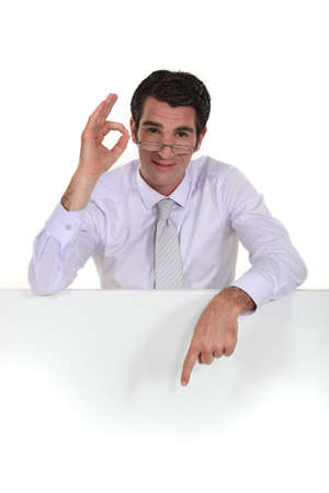 low glass: Businessman giving his sign of approval