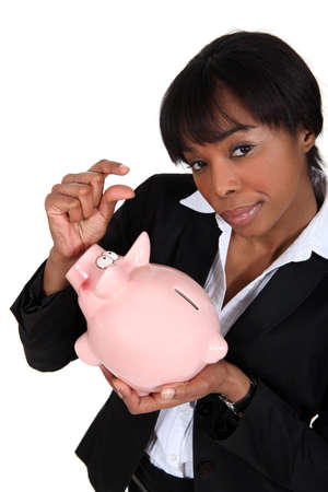 black businesswoman with piggybank photo
