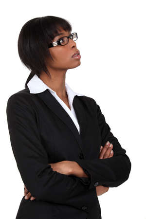 deep thought: Businesswoman deep in thought Stock Photo
