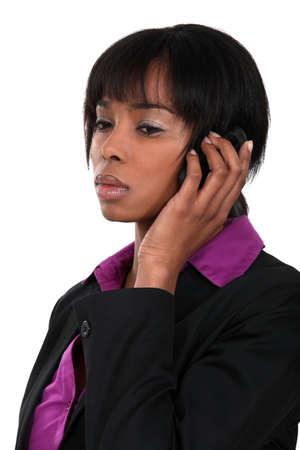 young woman listening to the phone Stock Photo