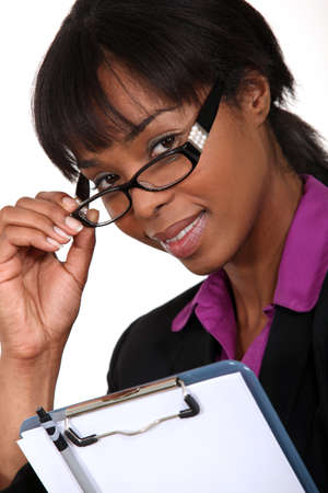 Businesswoman peering over her glasses photo