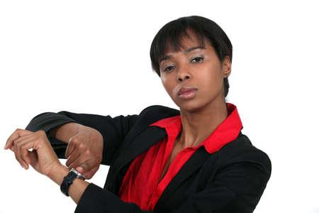 female boss: Eine weibliche Chef erinnert die Zeit.
