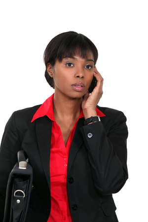 Young Afro-American woman on phone photo