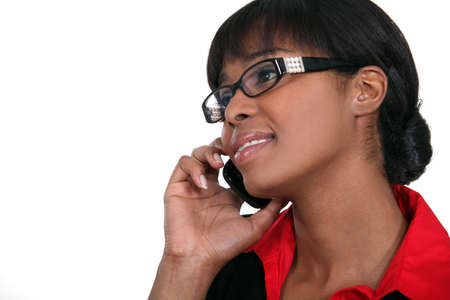 business woman phone: Businesswoman taking a call from client Stock Photo