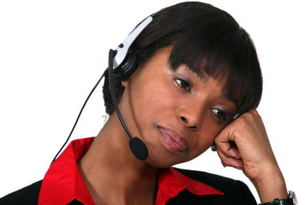 Bored woman wearing a headset photo