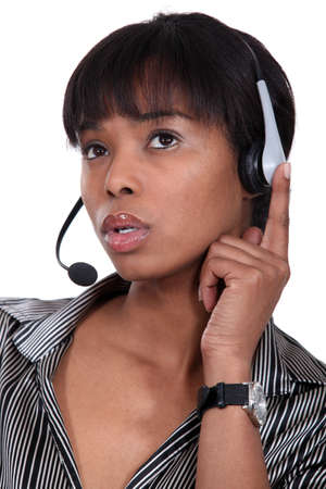 telephone headset: Pensive call-center worker