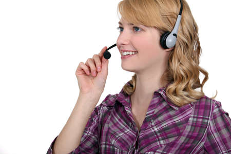 switchboard: Friendly woman with a telephone headset Stock Photo