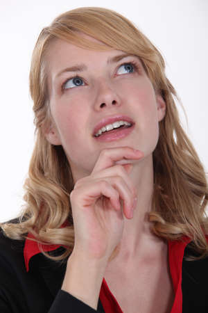 wondering: woman wondering and holding her chin