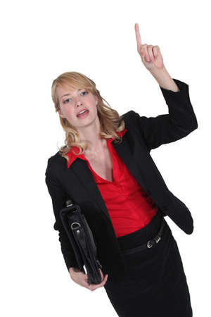attention grabbing: Businesswoman hailing a cab
