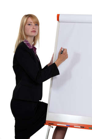 secretary skirt: businesswoman writing with a marker on a board Stock Photo