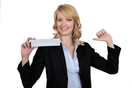 the chosen one: Blond businesswoman pointing at herself