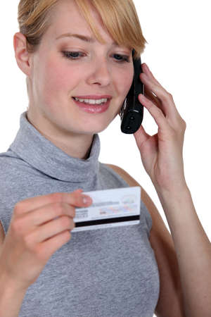 halterneck: Woman on the phone with her credit card company