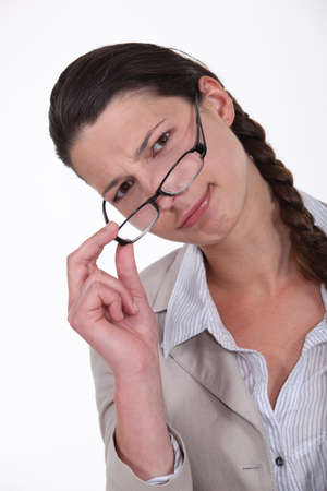 scrunch: Woman peering over her glasses Stock Photo