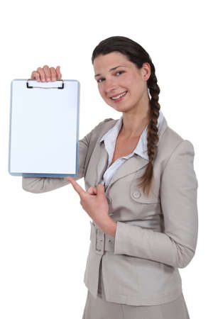 Woman pointing to blank clip-board photo