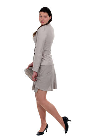 clothes interesting: Elegant woman posing with beige suit