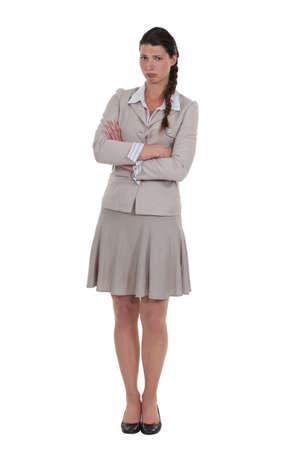in low spirits: beautiful businesswoman in low spirits