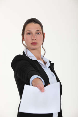 Woman holding out a contract photo