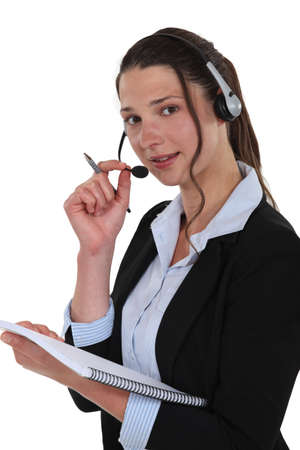 Telephony operator with notebook photo