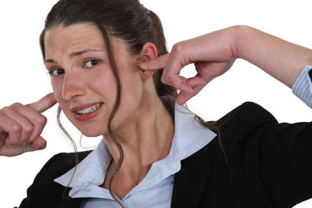 plugging: woman plugging her ears