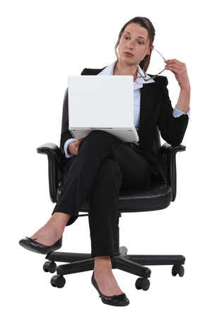 noun: A bored businesswoman.