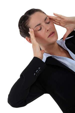 splitting headache: Woman suffering from a throbbing headache
