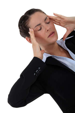 cephalgia: Woman suffering from a throbbing headache