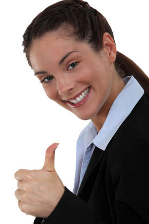 eager: Excited woman giving the thumbs up Stock Photo