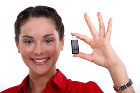 Brunette holding USB stick