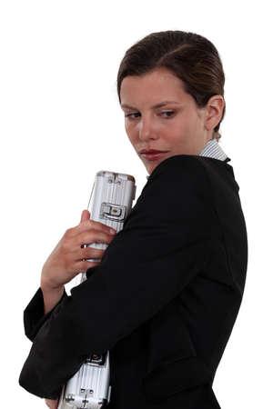 clutching: Woman clutching metallic briefcase