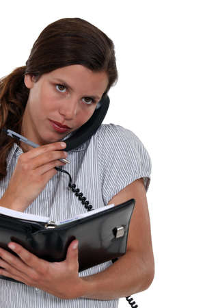 scheduling: Receptionist scheduling an appointment Stock Photo
