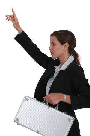 hailing: Businesswoman hailing a cab. Stock Photo