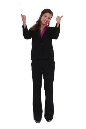 A businesswoman giving both thumbs up. photo