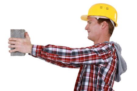 prefabricated: Mason carrying building block